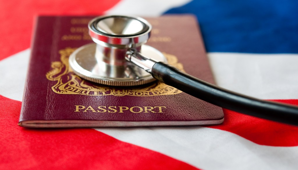 United Kingdom Passport and stethoscope